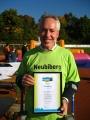 Der Erste Bürgermeister Günter Heyland bekam die Urkunde mit dem Titel